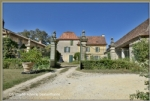 Close to Bergerac, small chateau with outbuildings on an elevated 29 hectare site