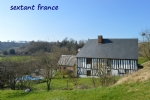 Equestrian property with house and gite, pool, sand school, 4 boxes, outbuildings set in 8 hectares.