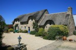 Thatched gites with heated swimming pool