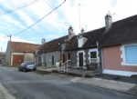 Cottage with garage in small village with short walk to river.