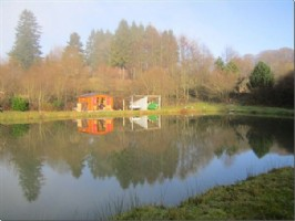Almost 5 acres of land, 2 lakes stocked with trout and carp, with woodland.