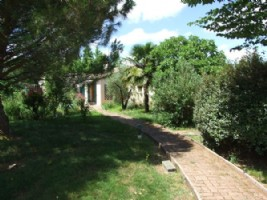 Bungalow over basement, fenced grounds of around 2 acres.
