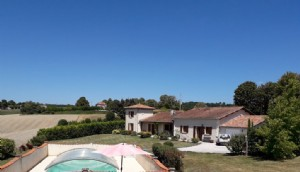 Modern family home with wonderful countryside views, village location, pool and 4 bedrooms