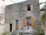 For renovation: village house 50 M² with walled patio garden and garage
