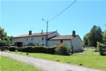 Countryside house with 1.5 acres and barn, near town.