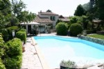 Spacious village house, a former winery, with 2 guest houses, garage, nicely exposed pool set in