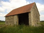 Farmers barn and the ruin of a former farmers house on 1 he...