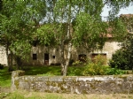For sale, beautiful stone house with garage, barn and grounds.