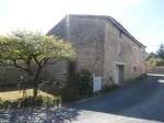 Stone house in good condition, with attached barn and courtyard