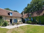 Wonderful farmhouse with beautiful wine cellars and a lovely garden with mature trees