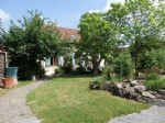 A Top Quality Renovation for this Hamlet Property with Beautiful Garden.