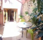 Pretty stone renovated village house with 140 m² of living space, workshops and terraces.