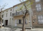 Stone village house with 133 m² of living space, 3 bedrooms, garage, annexes and terraces.