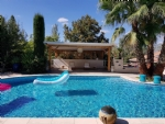 Charming home with 2 annexes and 2665 m² with a pool, views onto the river and near town.