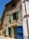 Pretty village house with 45 m² living space and roof terrace with breathtaking views .