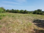 Building plot with 2465 m² plus a private alleyway of 764 m², not in an estate area with views.