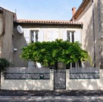 Spacious village house with 4 bedrooms, garage, courtyard and possibility to create a gite.