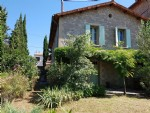 Pretty renovated stone village house with 160 m² of living space on 671 m² of landscaped land.
