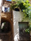 Pretty village house with 77 m² of living space, vaulted cellar and 2 terraces, near Pezenas.