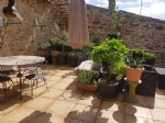 Renovated bright village house with 4 bedrooms, large garage, terraces and views.