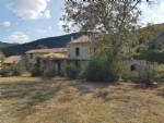 Former water mill with main house and 4 gîtes on 5385 m² with access to river and views.