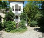 Character home with 320 m² of living space on 1825 m² with pool and outbuildings.