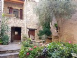 Renovated stone house with gite, studio, cellars, courtyard of 50 m² and terraces with views.