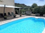 Pretty villa offering 2 apartments on 1010 m² with pool, terraces and views.
