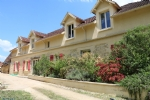 Close to Hautefort: Large stone house, 300m², with guest house and covered swimming pool.
