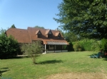 In CORMEILLES, south-facing, beautiful Neo-Norman style house hidden in a green oasis