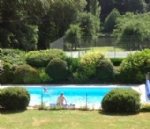 House with swimming pool, tennis courts and river access.