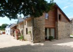 Pretty stone house with two gites and heated pool.