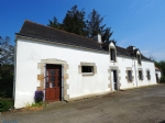 Longere style house in need of renovation in a typical small village