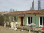Single storey property typical Provencal style- pastel coloured shutters and terracotta tiles