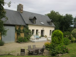 Old stone farmhouse which has been renovated and extended at one end, with original old barn