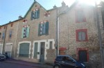 Village house with house to renovate, 2 garages and a beautiful garden.