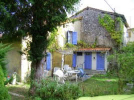 Village house for renovation with outbuildings and an acre.
