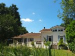 Two architect designed houses in 7+ acres of grounds. Small lake