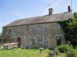 Lovely stone house with attached barn and paddocks
