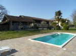 L shaped farmhouse with pool on 3700 m² of land