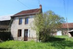 In the 3 Lakes area, a semi detached stone house to finish, with land.