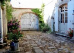 In the heart of an historical town, an exceptional house from the 18th century with garden