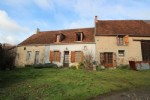 A property comprising 2 habitable houses and a house to restore. Barn.