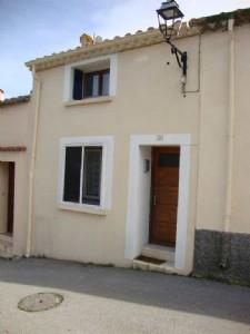 Village house with garage