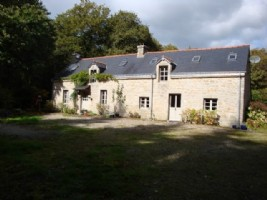 Traditional stone built Breton farmhouse, with lake, and woodland