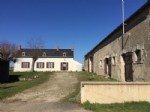 Huge potential! Farmhouse and extensive outbuildings