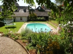 Attractive, well maintained town house with garden and swimming pool