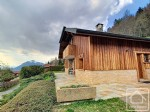 Chalet of 158 m2 with 4 bedrooms, land of 1982 m2, plus garage, mazot and bread oven.