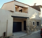 Barn converted into habitation with 114 m² of living space, garage, courtyard and terrace.