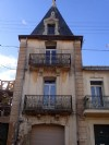 Pretty town house with tower, 97 m² of living space, attic to renovate, garage and garden !